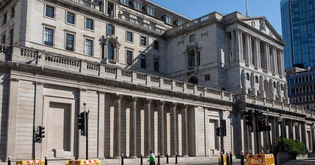 LONDON, ENGLAND - JUNE 01: A woman walks past the Bank of England on June 01, 2020 in London, England. The British government further relaxed Covid-19 quarantine measures in England this week, allowing groups of six people from different households to meet in parks and gardens, subject to social distancing rules. Many schools also reopened and vulnerable people who are shielding in their homes are allowed to go outside again. (Photo by Dan Kitwood/Getty Images)