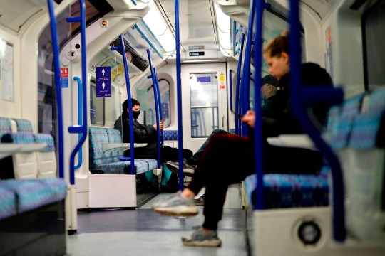 London commuters on tube in mask