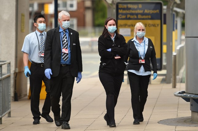Members of staff wearing PPE (personal protective equipment) at Manchester Airport