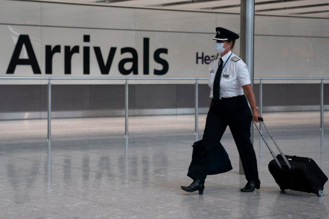 A crew member at Heathrow Airport, London