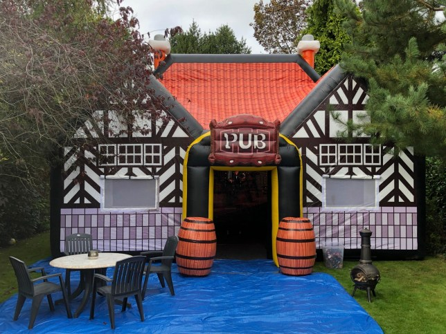 MERCURY PRESS. Manchester, UK. (Pictured: The exterior of the Tudor inflatable pub.) People missing their local due to lockdown restrictions can now pull pints from their back garden in a giant inflatable pub. Punters can now hire the 40-person capacity pop-up pub for ?495, complete with beer hall tables, benches and a sound system - even though government rules mean you can currently only have five mates to join you. The distinctive Tudor-style expanding pub is finished with a traditional wooden bar and inflatable kegs and is 20ft high, 25 ft in length and measures 20 ft in width - meaning social distancing will be easy. (SEE MERCURY COPY)