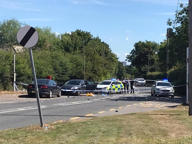 A large police cordon show a huge emergency response after a man was shot