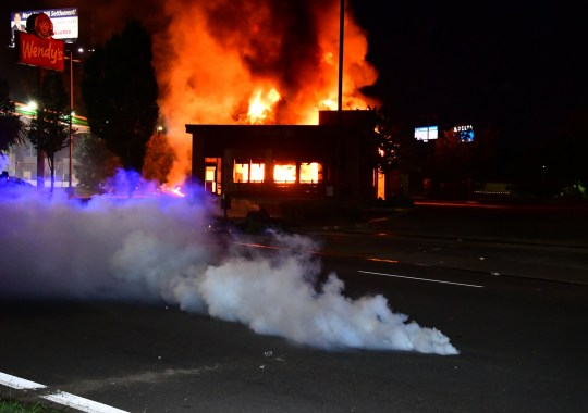 ATLANTA, GA - JUNE 13: A Wendys restaurant burns after protesters allegedly set it on fire on June 13, 2020 in Atlanta, Georgia. Fresh protests rose up after an Atlanta police officer shot and killed Rayshard Brooks, an unarmed African American man outside the restaurant. . (Photo by Scott Cunningham/Getty Images)