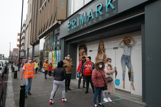 Shoppers wearing face masks in line for Primark in Newcastle