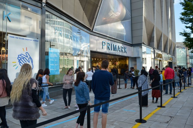 Shoppers queue at Primark in Birmingham as non-essential shops in England open their doors to customers for the first time since coronavirus lockdown restrictions were imposed in March. PA Photo. Picture date: Monday June 15, 2020. See PA story HEALTH Coronavirus. Photo credit should read: Jacob King/PA Wire