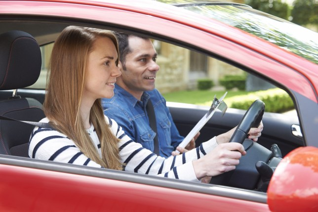 Woman Having Driving Lesson With Instructor; Shutterstock ID 341113520; Purchase Order: -