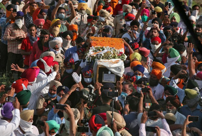 People carry the coffin of Satnam Singh, an Indian soldier who was killed in a border clash