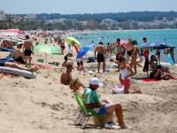 People sunbathe on Playa de Palma beach in Mallorca, as Spain officially reopens the borders amid the coronavirus disease (COVID-19) outbreak, in Palma de Mallorca, Spain June 21, 2020. REUTERS/Enrique Calvo