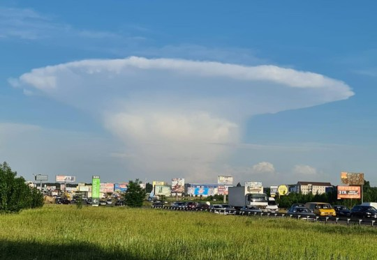 Pics Shows: Kiev was covered by an unusual cloud in the form of a nuclear mushroom; These images show how Kiev has been covered in a mushroom-shaped cloud with a startling similarity to those left by a nuclear explosion leaving netizens to speculate on its origin.