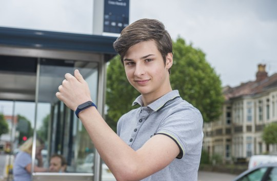 Max Melia. A teenage entrepreneur is helping fight coronavirus by inventing a wristband which alerts users when they are about to touch their face. See SWNS story SWBRface. A teenage entrepreneur is helping fight coronavirus by inventing a wristband which alerts users when they are about to touch their face. Max Melia, 15, designed and developed the wearable device in a bid to help and protect the public during the pandemic. He first came up with the helpful concept two years ago as a way of reducing the spread of cold and flu. Max then threw all his efforts into developing a working prototype four months ago after both his parents were struck down by COVID-19.