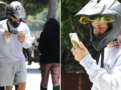 Justin Bieber engages in FaceTime call while out and about in Beverly Hills