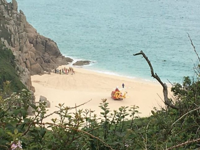 A dad has died after getting into difficulty whilst bathing in the sea with his son off the coast of Cornwall. Falmouth Coastguard confirmed that the man's body had been recovered from the water at Porthcurno this afternoon [June 25]. Caption: Cornwall Air Ambulance on the scene at Porthcurno beach, where a man died after getting into trouble in the water on June 25, 2020
