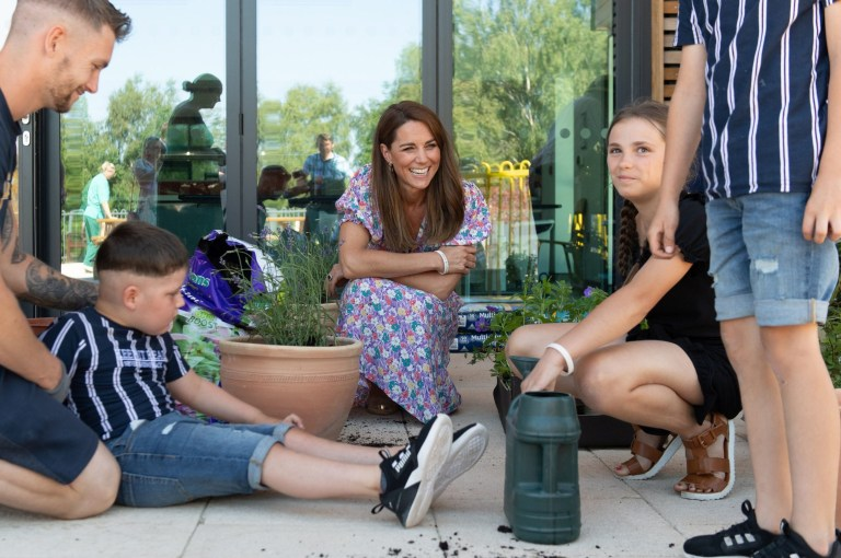 EMBARGOED: No onward transmission before 2100 BST Sat 27/6/2020. Not for publication before 2200 BST Sat 27/6/2020. The Duchess of Cambridge talks with Sonny Saunders (seated left), his father Jordan, sister Star, and brother Hudson (standing right), during a visit to The Nook in Framlingham Earl, Norfolk, which is one of the three East Anglia Children's Hospices (EACH). Sonny was diagnosed with a diffuse intrinsic pontine glioma, an aggressive and difficult-to-treat brain tumour, only a week or so after his sixth birthday in February. PA Photo. Picture date: Thursday June 25, 2020. The Duchess is the Royal Patron of the charity which offers care and support for children and young people with life-threatening conditions and their families across Cambridgeshire, Essex, Norfolk and Suffolk. See PA story ROYAL Kate. Photo credit should read: Joe Giddens/PA Wire