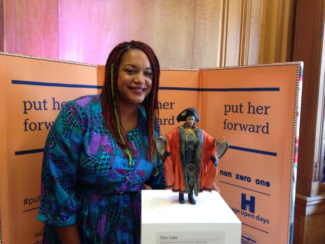 Cleo with a statue of herself as Lord Mayor