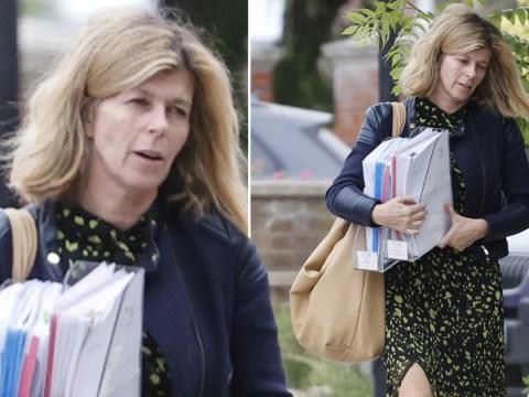 Kate Garraway heads home with armfuls of paperwork after heartbreaking update on Derek
