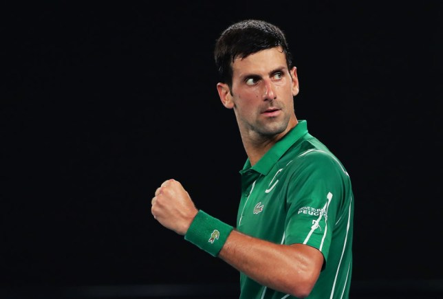 Novak Djokovic of Serbia celebrates after winning set point during his Men's Singles Semifinal match against Roger Federer of Switzerland on day eleven of the 2020 Australian Open at Melbourne Park on January 30, 2020 in Melbourne, Australia.