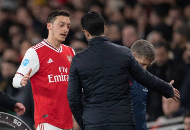 Mesut Ozil shakes hands with Mikel Arteta during Arsenal's Premier League clash with Newcastle United