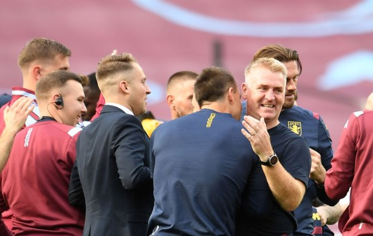 Aston Villa's English head coach Dean Smith (R) hugs Aston Villa's English assistant manager John Terry (C) at the end of the game following the English Premier League football match between West Ham United and Aston Villa at The London Stadium, in east London on July 26, 2020. (Photo by Andy Rain / POOL / AFP) / RESTRICTED TO EDITORIAL USE. No use with unauthorized audio, video, data, fixture lists, club/league logos or 'live' services. Online in-match use limited to 120 images. An additional 40 images may be used in extra time. No video emulation. Social media in-match use limited to 120 images. An additional 40 images may be used in extra time. No use in betting publications, games or single club/league/player publications.