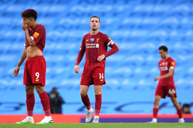 Jordan Henderson looks dejected after Liverpool go behind