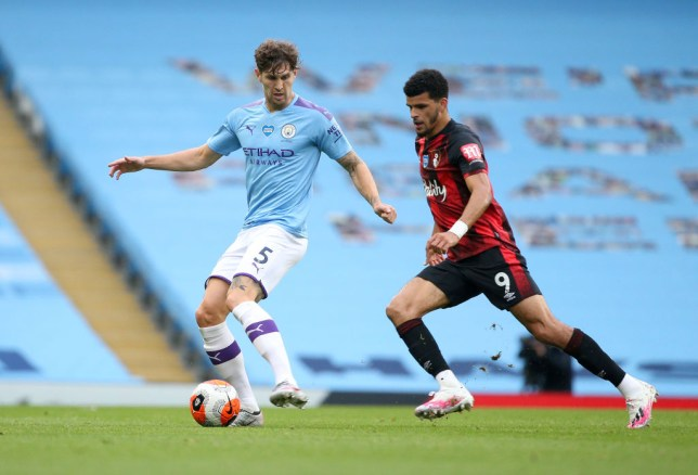 John Stones runs with the ball during Manchester City's Premier League clash with Bournemouth