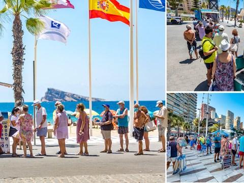 Huge queues in Benidorm as tourists wait to sunbathe on beach