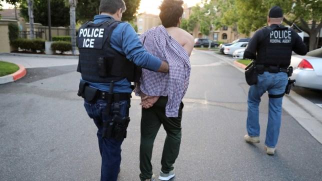 ICE arresting a man