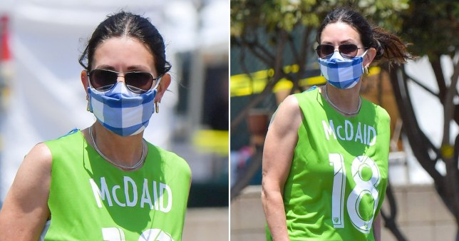 Courteney Cox pictured with Johnny McDaid's name on her top and wearing a face mask out in Malibu