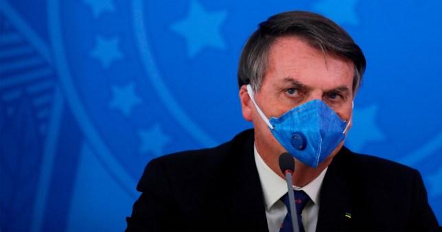 Jair Bolsonaro wearing a face mask