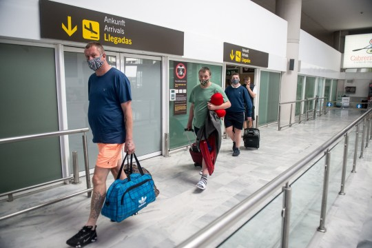 epa08503863 Tourists from Manchester arrive at Lanzarote airport in St. Bartolome, Lanzarote island, Canary Islands, Spain, 23 June 2020. The first international flight landed in Lanzarote since Spanish borders re-opened after it were closed due to COVID-19 outbreak. EPA/JAVIER FUENTES