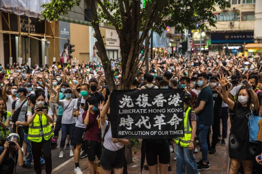 Protesters chant slogans during a rally against a new national security law in Hong Kong