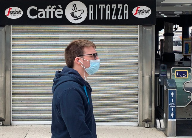 A pedestrian wearing PPE during the coronavirus pandemic