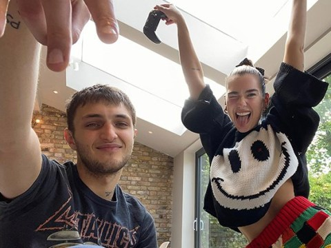 Dua Lipa hangs out at home with boyfriend Anwar Hadid as couple join celebs for Vogue's families under lockdown shoot