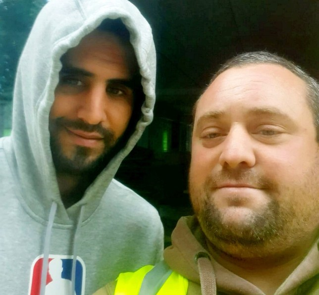 EMBARGOED - NO USE BEFORE 2PM BST / JULY 2, 2020. Man United fan Craig Willis who was sacked after breaching social distancing guidelines to get a selfie with rival City ace Riyad Mahrez. A Man United fan lost his job on his first say after breaking COVID-19 restrictions - to get a selfie with Man City star Riyad Mahrez. See SWNS story SWTPmahrez. Groundworker Craig Willis, 37, said he was shown the red card by bosses after asking the star for a photo - within hours of starting. He had been hired by an agency to look after paving at a luxury apartment complex but failed to follow strict coronavirus rules. Dad-of-five Craig said he spotted the pacy Algerian winger, 29, while he was being shown around and approached him for a snap. He claims that Mahrez seemed happy to pose with him - even giving him a fist bump afterwards. But Craig said he was called by his supervisor while on the way home on Monday (June 29) and told not to return the next day. He had signed a form which made it clear that getting within two metres of anyone on the site near Macclesfield, Cheshire was cause for instant dismissal.