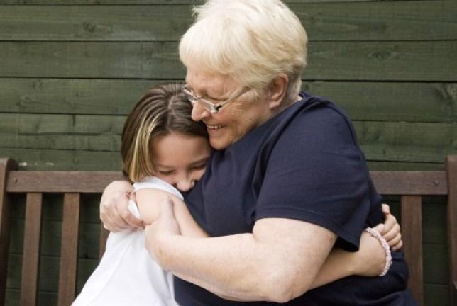 A grandmother hugging her granddaughter
