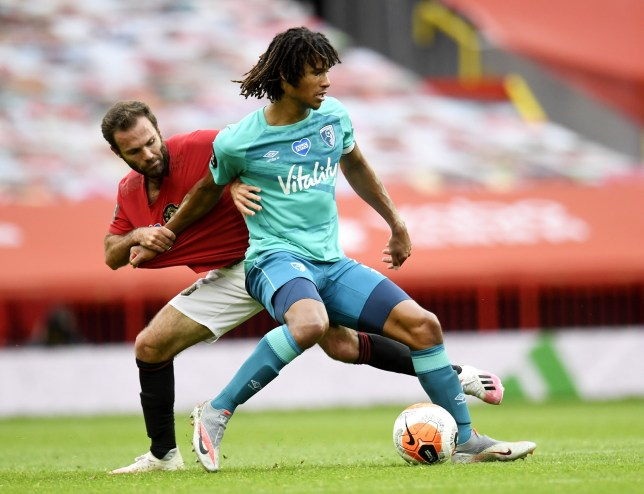 epa08526949 Juan Mata (L) of Manchester United in action against Nathan Ake of Bournemouth during the English Premier League match between Manchester United and AFC Bournemouth in Manchester, Britain, 04 July 2020. EPA/Peter Powell/NMC/Pool EDITORIAL USE ONLY. No use with unauthorized audio, video, data, fixture lists, club/league logos or 'live' services. Online in-match use limited to 120 images, no video emulation. No use in betting, games or single club/league/player publications.