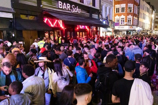 epaselect epa08528369 Revellers drink and socialize in the street during the evening in Soho, London, Britain, 04 July 2020 (issued 05 July 2020). Pubs, restaurants, places of worship, hairdressers and other businesses have reopened their doors across the UK on 'Super Saturday' after more than three months of lockdown due to the coronavirus pandemic. EPA/VICKIE FLORES