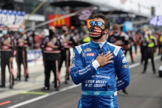 NASCAR Cup Series driver Bubba Wallace (43) stands during the national anthem before a NASCAR auto race at Indianapolis Motor Speedway in Indianapolis, Sunday, July 5, 2020. (AP Photo/Darron Cummings)