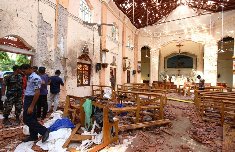 Sri Lankan officials inspect St. Sebastian's Church in Negombo, north of Colombo, after multiple explosions targeting churches and hotels across Sri Lanka on April 21, 2019, in Negombo, Sri Lanka.