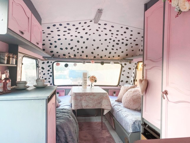 ellie sharkey and charlotte tasker's caravan after its amazing DIY transformation, complete with pink chalk paint, dalmatian spots, and cute seating