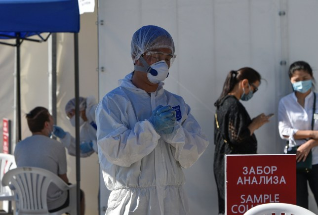Medical specialists wearing protective equipment work at the Covid-19 testing facility in Almaty, Kazakhstan July 8, 2020