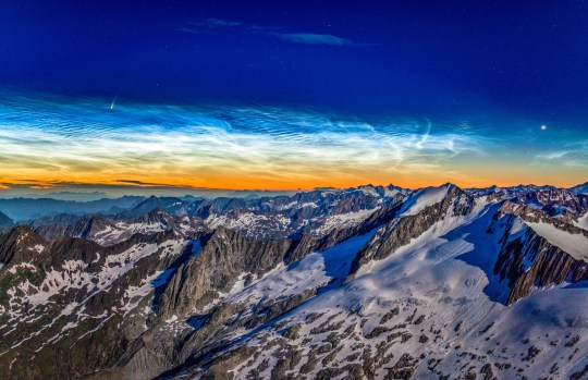 The Neowise comet seen above noctilucent clouds taken from the Hochfeiler mountain in the South Tyrol alps in Italy on 08/07/20. See SWNS copy SWCAcomet: A fiery comet streaks across a silvery sky in this stunning image which captures two rare astronomical phenomena at the same time. The blazing three-mile-wide fireball is the Neowise comet which is currently passing 64 millions away from the earth in a once in a lifetime spectacle. The comet is captured streaking across a sky-layered with beautiful Noctilucent - or 'night-shining' - clouds.