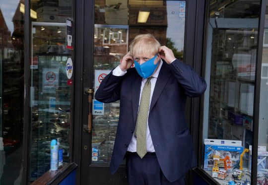 Image under license from Parsons Media. 07/10/2020. London, UK. Boris Johnson visits his constituency. Prime Minister Boris Johnson wearing a facial mask during the Coronavirus during a campaign in his riding of Uxbridge. Photo by Andrew Parsons / Parsons Media