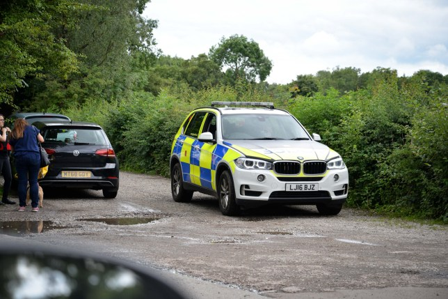 Police have launched a manhunt after a prisoner escaped from a hospital. Officers swooped on Reddish Vale Country Park in Stockport, Greater Manchester, during searches this afternoon [July 11]. Caption: Police at Reddish Vale Country Park in Stockport, Greater Manchester, searching for a man who escaped custody on July 11, 2020
