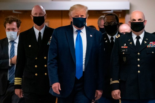 US President Donald Trump wears a mask as he visits Walter Reed National Military Medical Center in Bethesda, Maryland' on July 11, 2020. (Photo by ALEX EDELMAN / AFP) (Photo by ALEX EDELMAN/AFP via Getty Images)