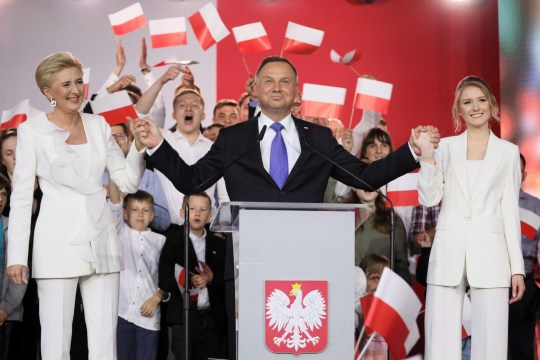 epaselect epa08542449 Incumbent President Andrzej Duda (C) with his wife Agata Kornhauser-Duda (L) and daughter Kinga Duda (R) gives statement after initial exit polls in Polish Presidential elections in Pultusk, Poland, 12 July 2020. According to initiall exit polls, Polish President Andrzej Duda has won percent 50.4 percent of votes and Civic Coalition candidate and Mayor of Warsaw Rafal Trzaskowski has won 49.6 percent of votes in the second round of presidential elections in Poland. EPA/LESZEK SZYMANSKI POLAND OUT