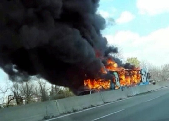 Fire pictured coming from school bus