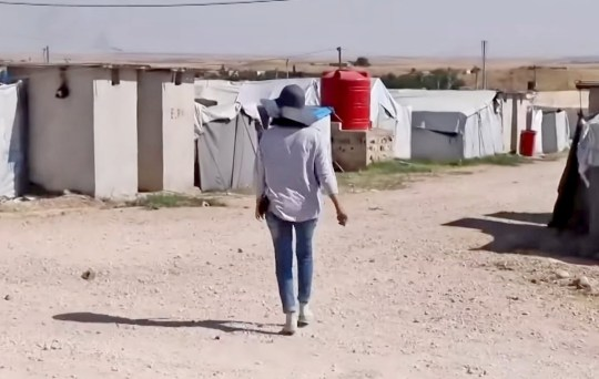 ITV News grab showing Shamima Begum walking away from camera at Syrian refugee camp (Picture: ITN)