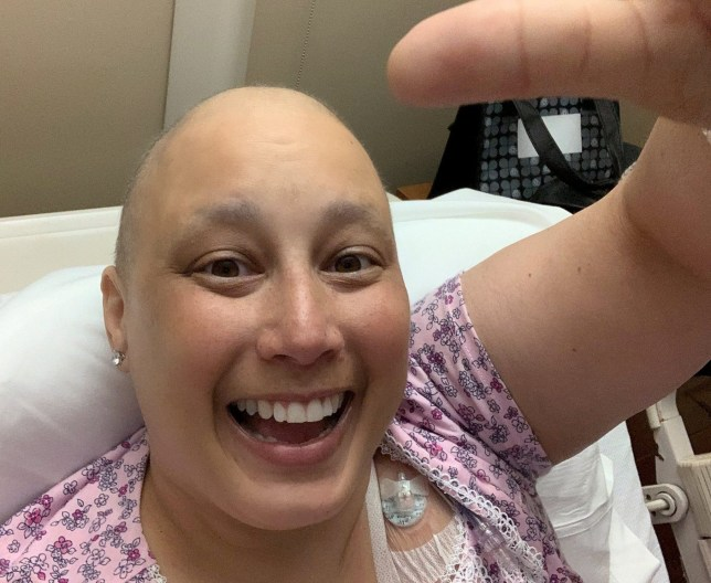 Kelly Garrison in hospital being treated for breast cancer