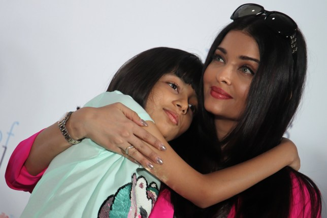 Indian actress Aishwarya Rai Bachchan hugs her daughter Aaradhya Bachchan during the celebration of her late father, Krishnaraj Rai's birth anniversary with kids from an NGO in Mumbai, India on 20 November 2019. (Photo by Himanshu Bhatt/NurPhoto via Getty Images)