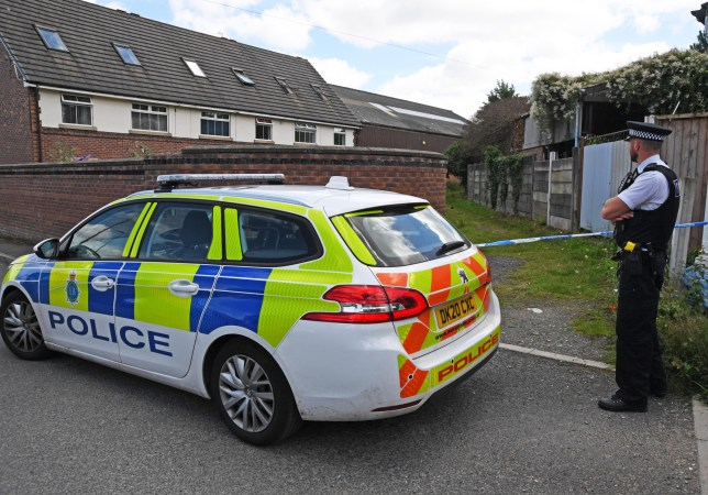 Merseyside Police scene in Prescot and pathway at the end of Eaton Street.